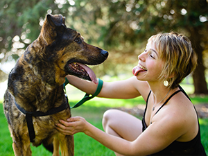 A woman playing with her dog by impersonating it